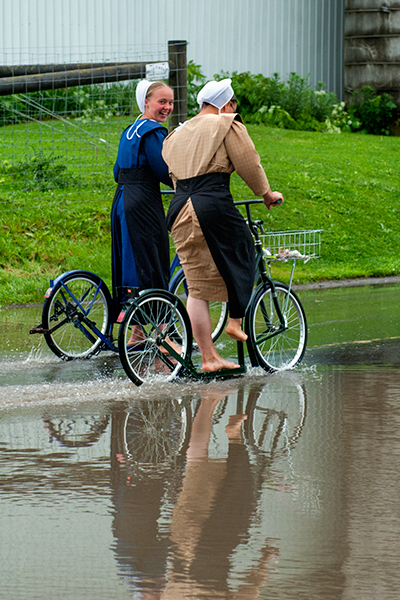https://reesephoto.files.wordpress.com/2016/06/amish-puddle-scooters.jpg